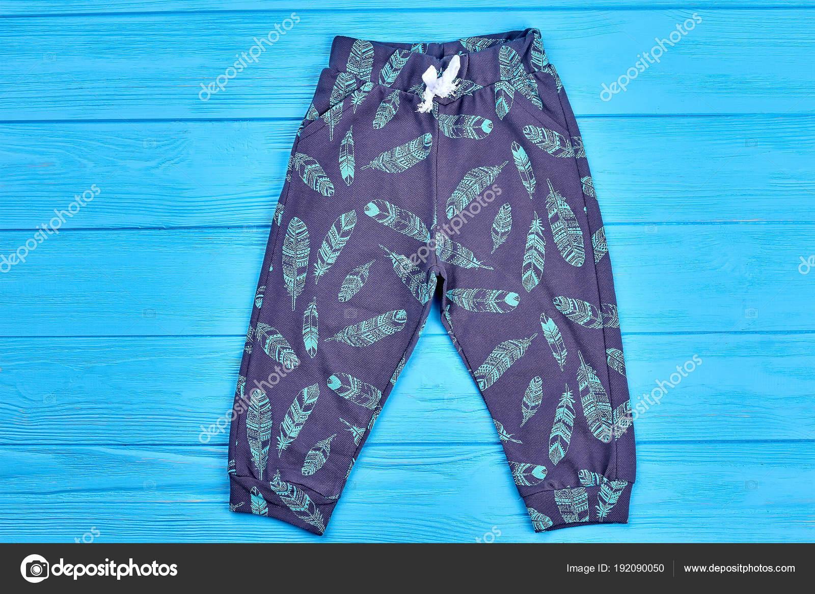 03c57e6853 Kids feather print autumn pants. — Stock Photo © Denisfilm  192090050