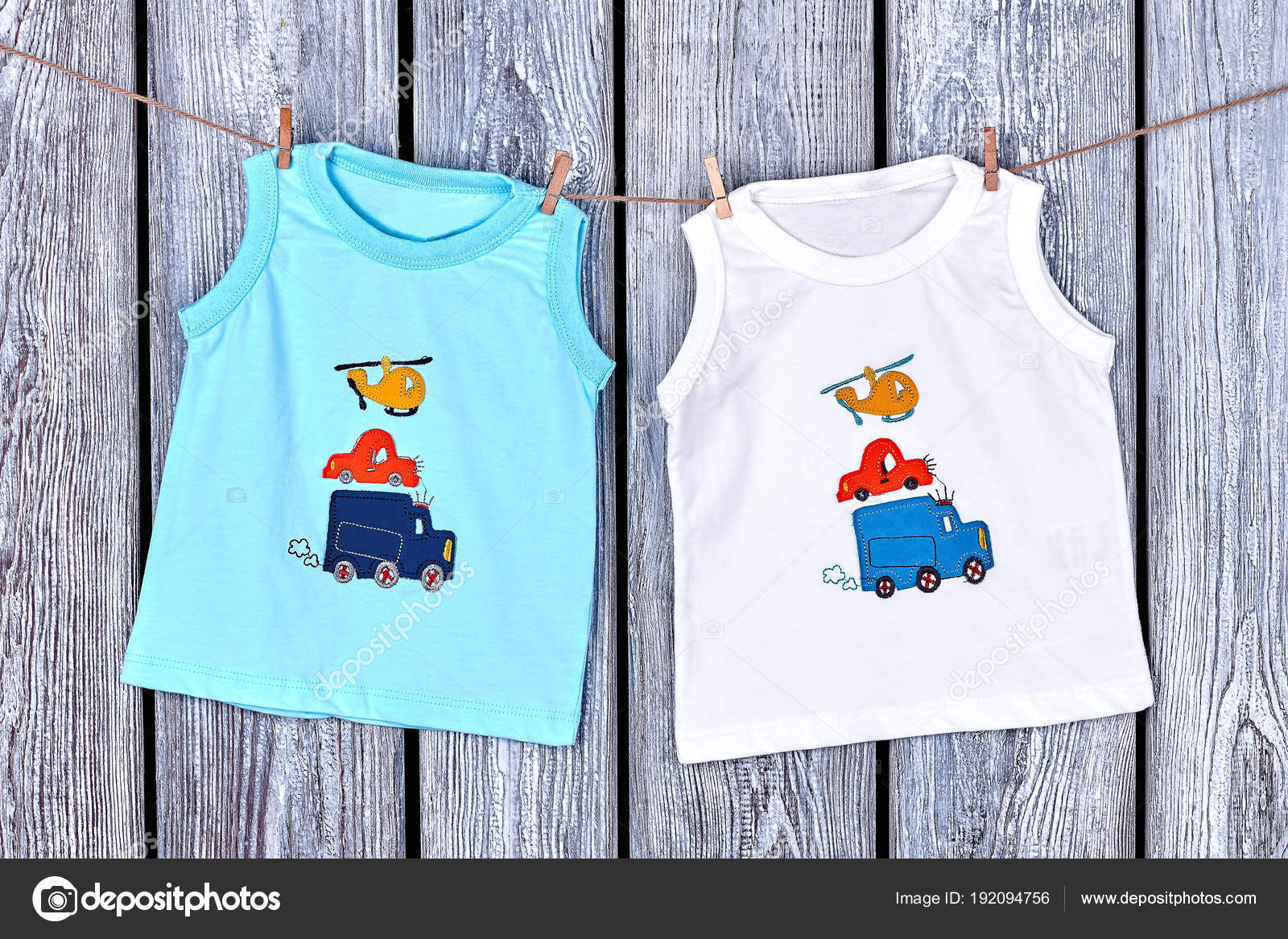 9a20164c6 Infant boy t-shirts hanging on rope. — Stock Photo © Denisfilm ...