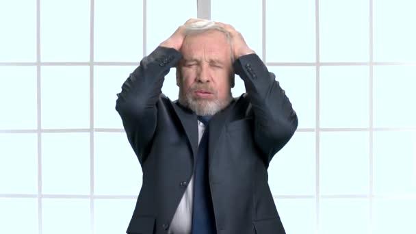 Stressed hopeless senior businessman in depression.