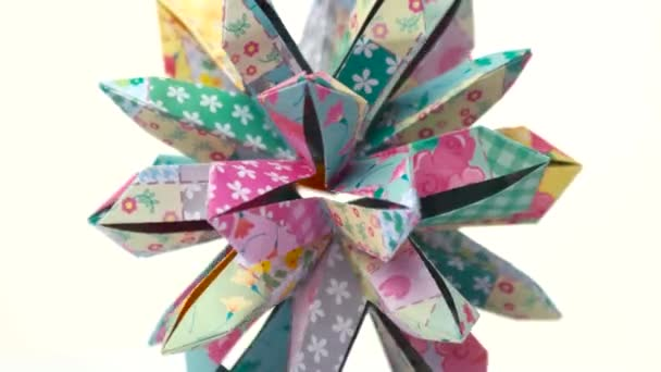 Patterned Origami Flower On White Background Stock Video