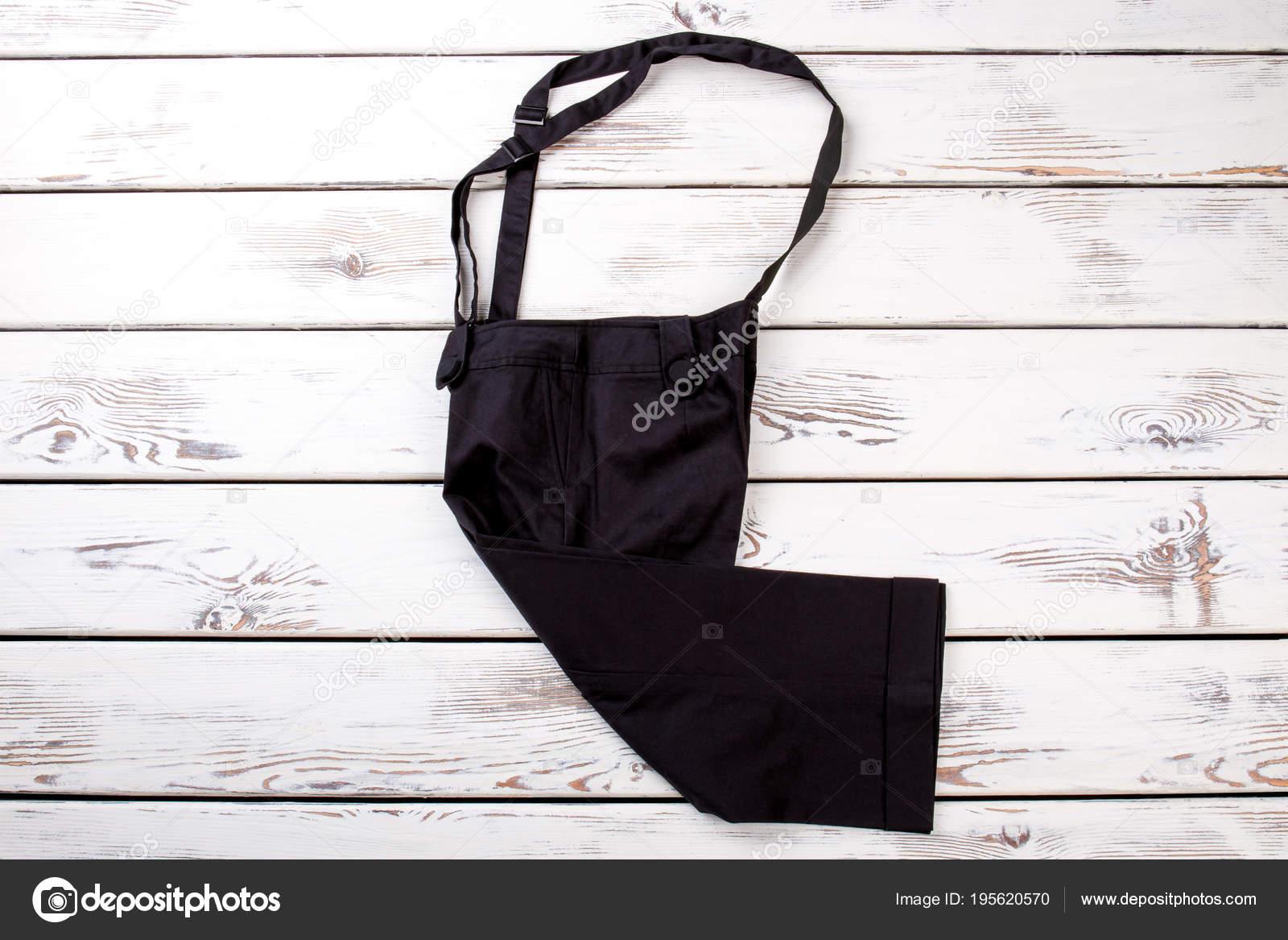 Zwarte broek met bretels. — Stockfoto © Denisfilm #195620570