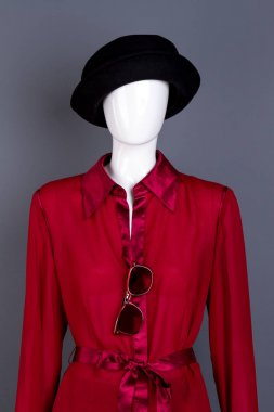 Mannequin wearing black hat and red blouse. Stylish feminine garment on dummy, grey background. Women spring elegant style. stock vector