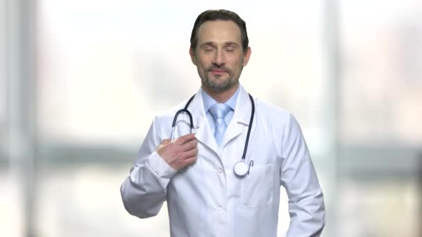 Portrait of smiling doctor with stethoscope.