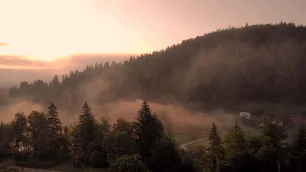 Early morning fog over summer slopes of Carpathian mountains.