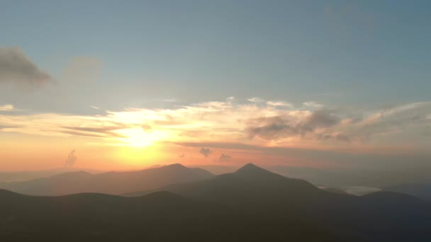 Picturesque sunset over mountains peaks.