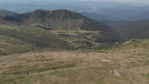 Green mountain peaks and valleys, aerial view.