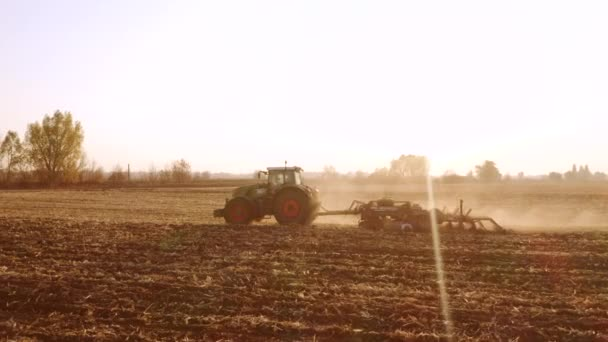 Tractor working on field on a sunny day.