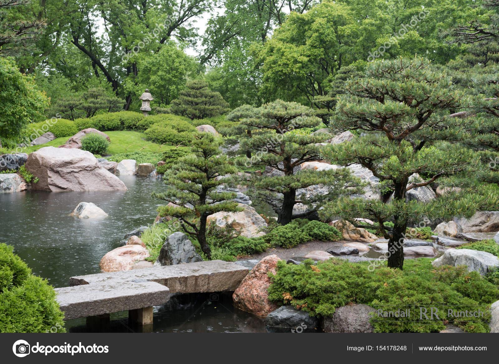A Stone Bridge Crosses Pond In Japanaese Garden Photo By Rruntsch
