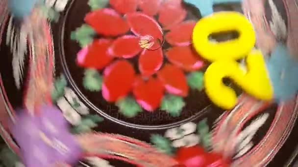 the colorful number 2018 revolves on a round wooden disk with painted flowers ornament