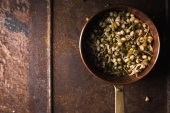 Fotografie Sprouting mung beans in a colander on the right