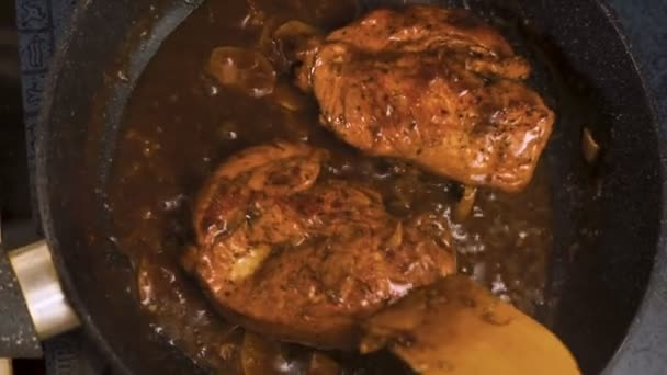 Chicken breasts with spicy chilli sauce in a saucepan top view video