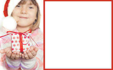 child with gift in hands. Selective focus.