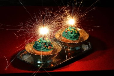 New Year cupcakes with sparklers. Cream Cupcakes