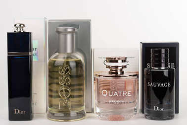 Four bottles and boxes of the fragrance for women and for men