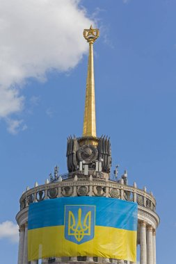 Ukrainian flag on the front of the building with the star, which