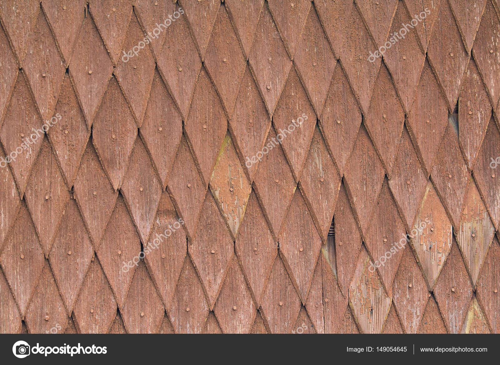 Mattonelle di legno con elementi in forma di rombi. texture e sfondi