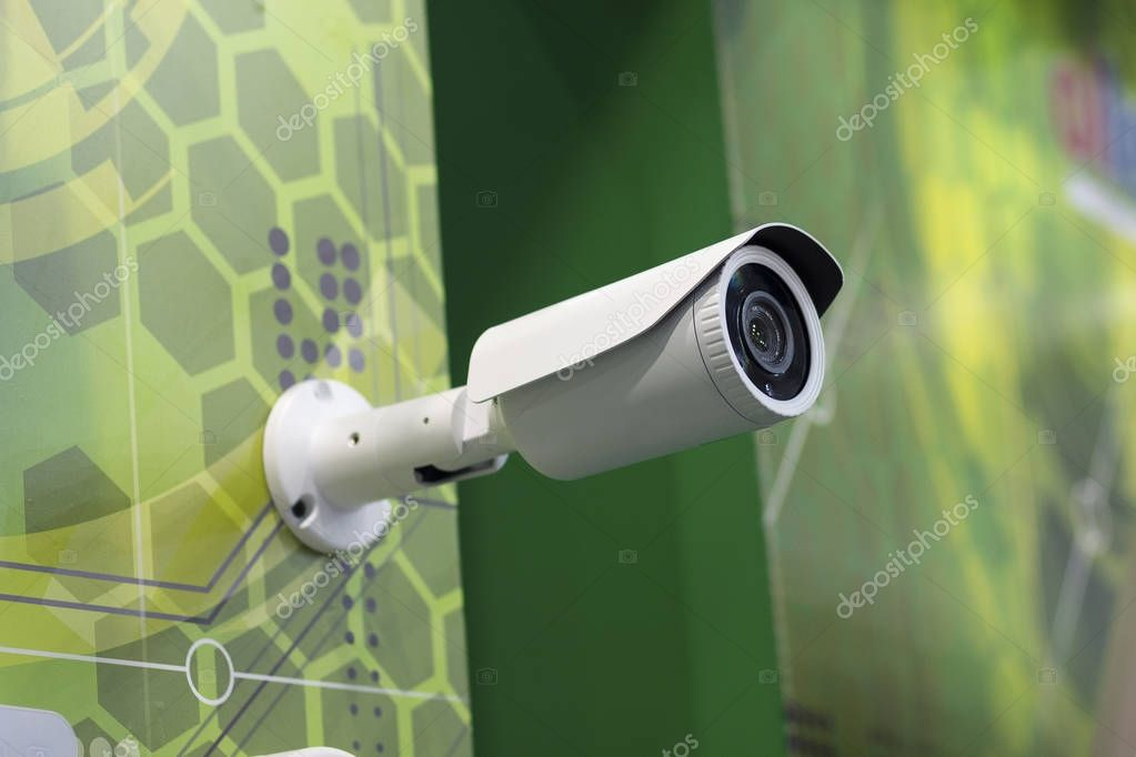 Surveillance camera is hanging on the wall. Electronics
