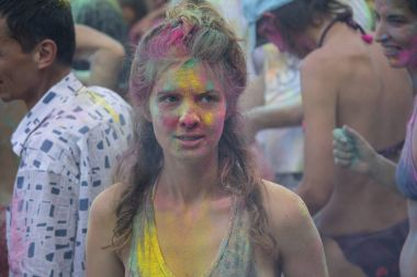 Kiev, Ukraine - August 06, 2017: Girl is stained with paint during the Holi festival at the festival of Vedalife