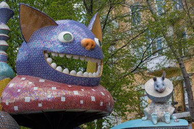 Kiev, Ukraine - April 22, 2018: Children's playground decorated styles characters tales of Lewis Carroll Alice in Wonderland on the Landscape Alley