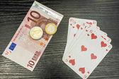 Fényképek Póker - Straight flush, a pénz és az euro-érmék