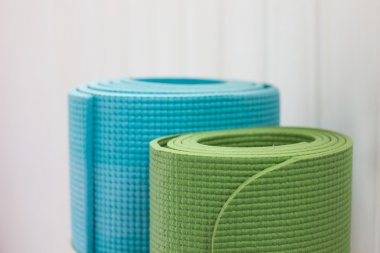 two twisted yoga mats