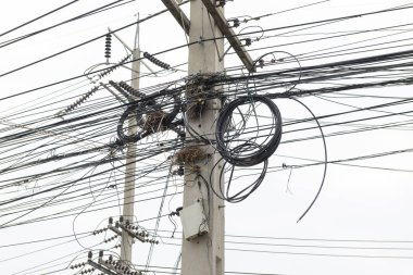 Messy cable and wires on electricity post