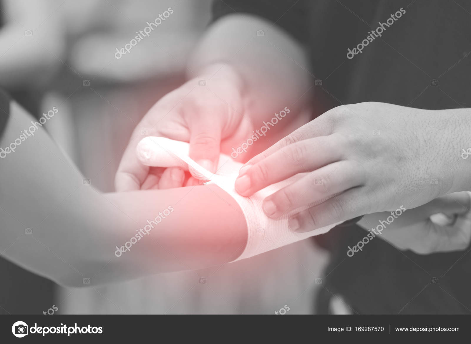 Close Up Of Bandaging Injured Hand After An Accident Stock Photo