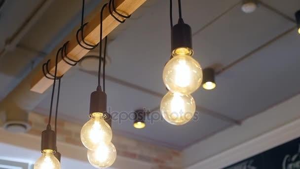 Old vintage light bulb. Set of vintage glowing light bulbs on black. light bulbs in the dark. Beautiful retro luxury interior lighting lamp decor