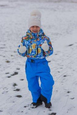 Girl walks winter day in overalls. heat it.