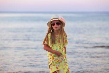 Portrait of adorable little girl wearing elegant hat