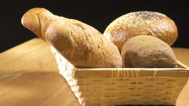 Bread of different kinds lies in the basket and spins on the table