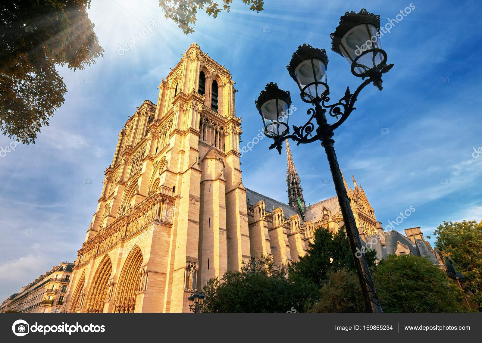 Notre-Dame Cathedral in Paris France with Golden Light Rays