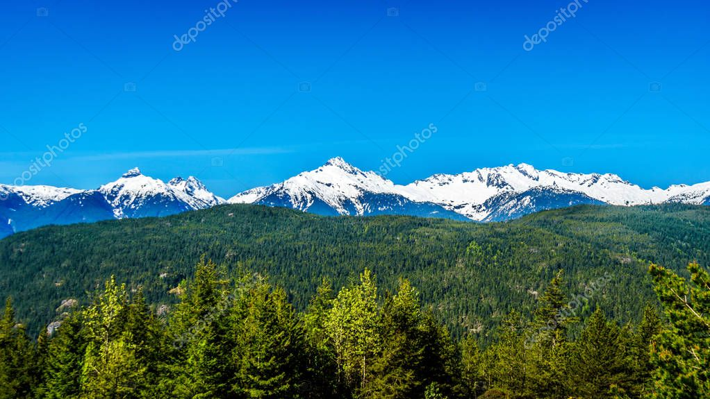 The snow covered peaks of Alpha Mountain, Serratus and Tantalus Mountain in British Columbia, Canada