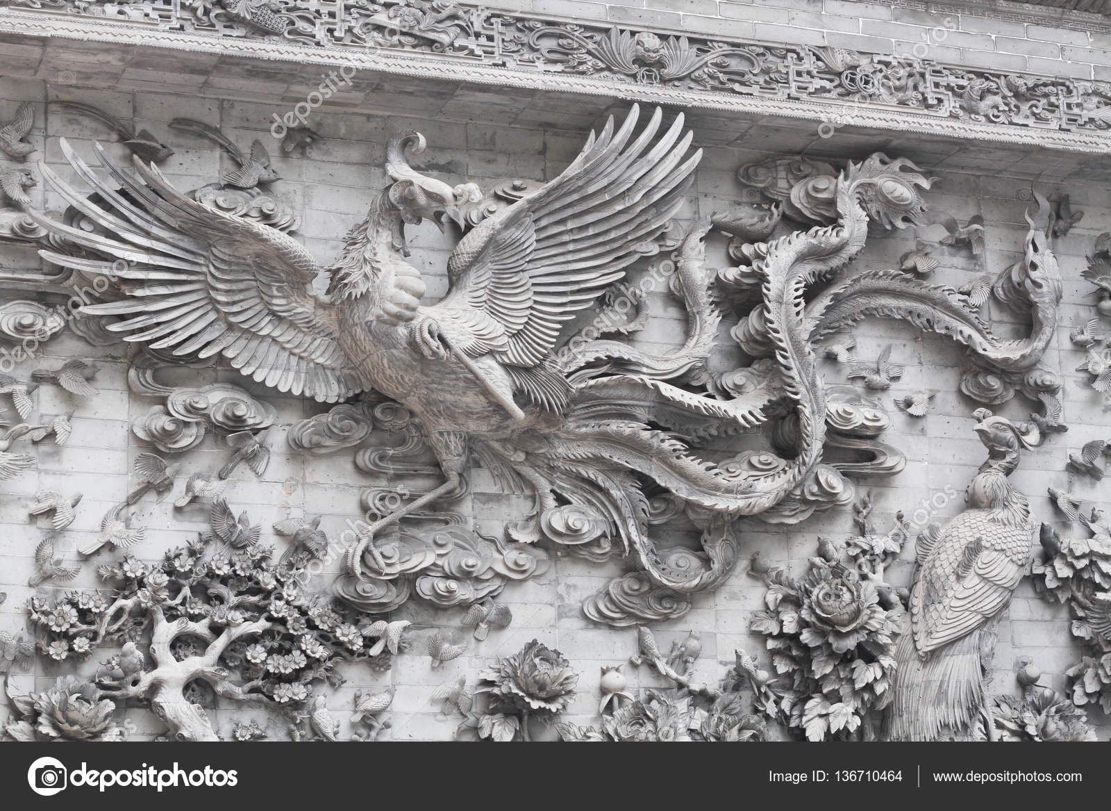 Stone wall sculpture of flying chinese swan flowers famous