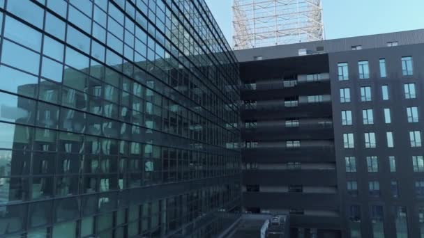 Aerial closeup of the glass facade of an office building. 4K