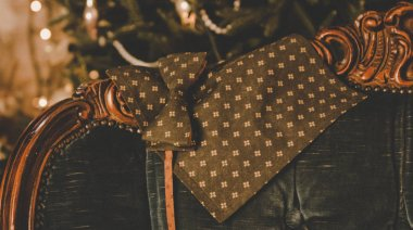 brown classic polka dot bow tie , cufflinks, men's scarf and neck tie on wooden present box
