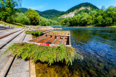 Wooden rafting boats on shore of Dunajec river, Pieniny Mountains, Poland