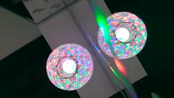 disco lights. DJ glowing ball. bright colors around.