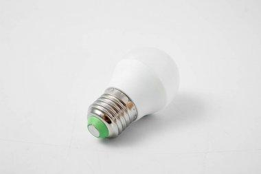 LED lamp with big cap on white background.