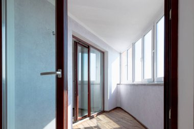 interior of a new apartment unfurnished kitchen bathroom balcony 2020