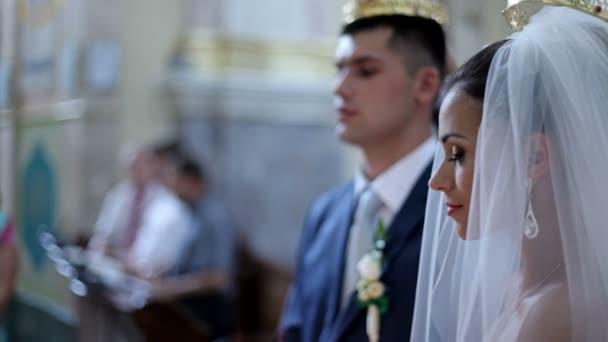 bride and groom standing at altar of church