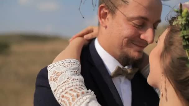 couple in love hugging in field