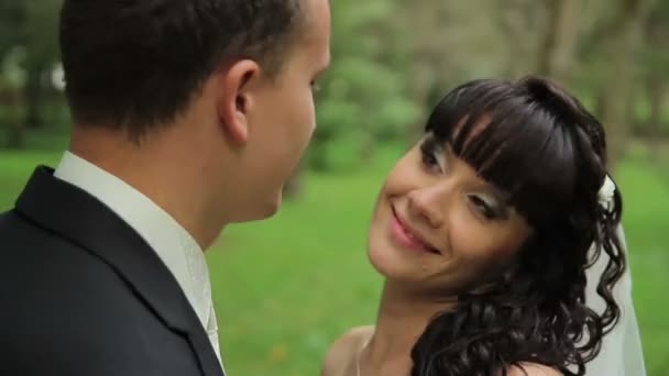 Portrait of newlywed couple in love in park. tenderness love