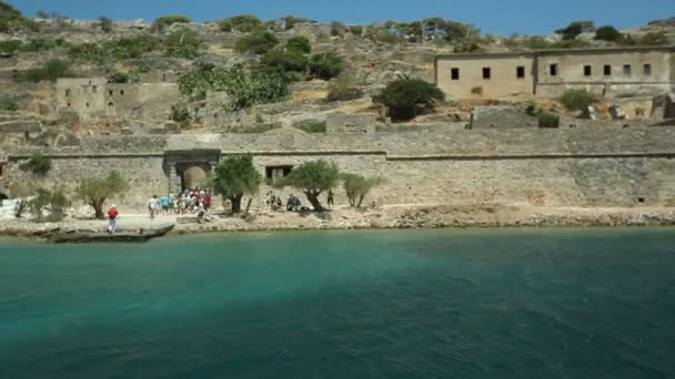 People go on an excursion to the fortress on the island of Spinalonga.