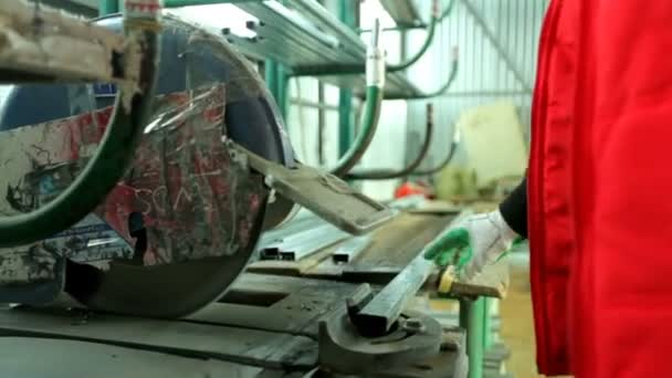 Workers in workshop. Line production of plastic windows.