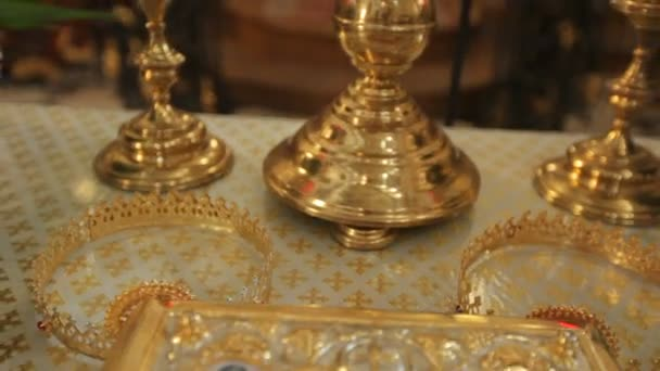 wedding crowns and church attributes for marriage on table in church, close-up