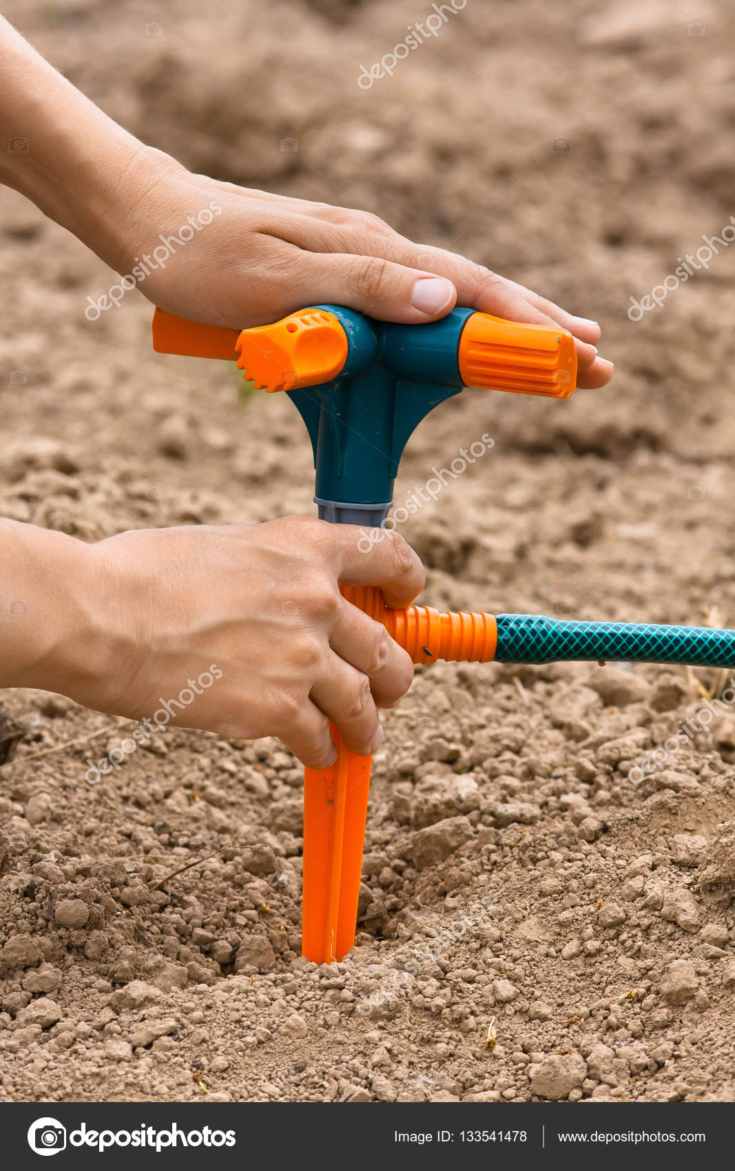 hand with sprinkler for garden irrigation — Stock Photo ...