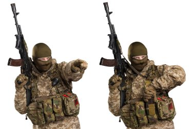 One soldier holding assault rifle. Uniform conforms to sub-unit of Russia's special forces Alpha Group FSB. Shot in studio. Isolated with clipping path on white background