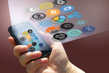 Virtual cryptocurrency - financial technology and internet money - smartphone in a hand and coin signs