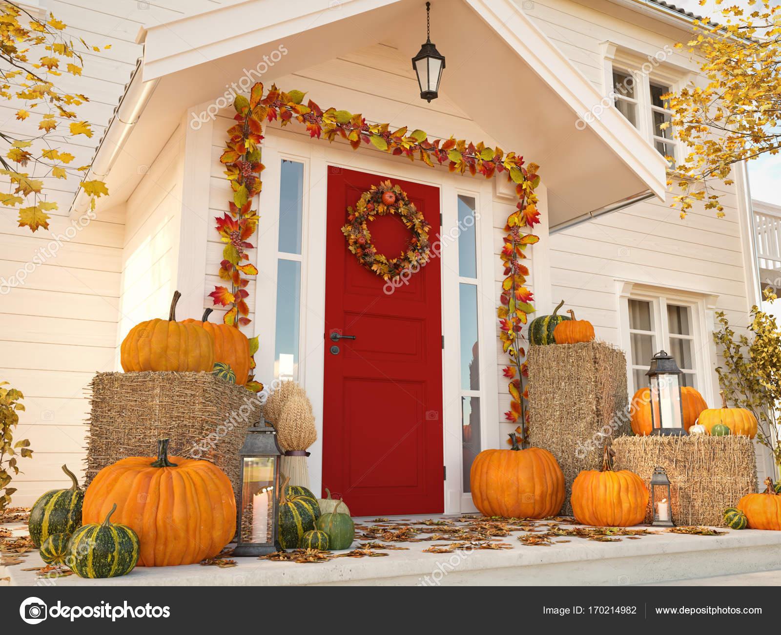 Herfst ingericht huis met pompoenen en hooi d rendering